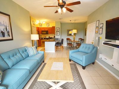 Photo for 11-104 ground floor, screened patio, Lake view, 4 miles from Disney, heated pool