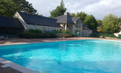 Photo for House in the heart of golf PLOEMEL (56400) in a calm residence with swimming pool