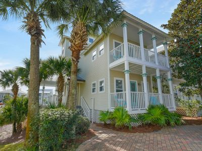 Photo for Charming getaway w/ lovely porches & shared pool - walk to the beach!