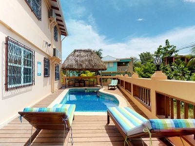 Photo for Bright villa with shared pool access in beautiful Placencia!