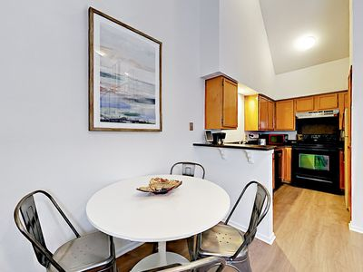 Dining Area - A galley-style kitchen is just off of the dining nook and living area.