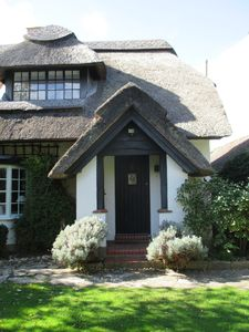Photo for Idyllic Thatched Cottage with Outdoor Swimming Pool in West Wittering