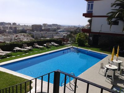 Photo for Apartment with pool and views over the city and the sea