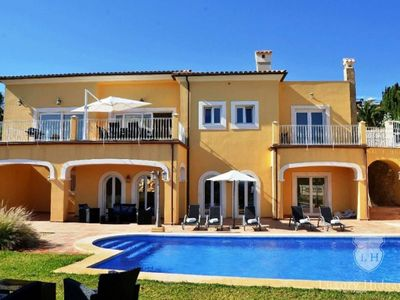 Photo for Modern villa by the sea with pool and fantastic views