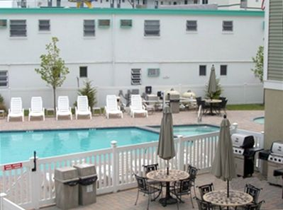 Front Pool w/Hot Tub & Kiddy Pool. Outside area incudes grills, eating area...
