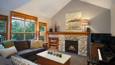 Spacious Living Area with Cozy Gas Fireplace and Vaulted Ceiling