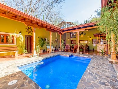 Photo for 5min walk to the beach, built for entertaining in down town Tamarindo