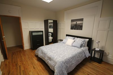 Queen size bed, wardrobe with mirror, dresser, bedside table & light, wood floor