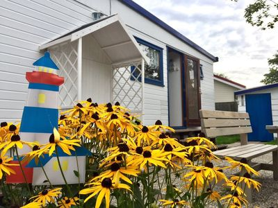 Photo for Nice chalet in the Vislust holiday park, 400 meters from the IJsselmeer.