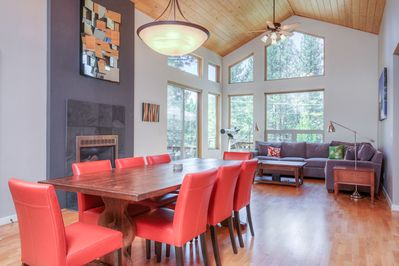 Dining Room - Share a meal at the modern, 8-person dining table beside the gas fireplace.