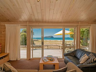 Photo for Absolute Beachfront Bach - Pauanui Holiday Home