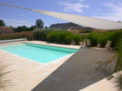 Photo for Private estate with 5 houses and a heated pool.
