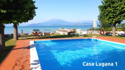 Photo for Studio with garden and swimming pool in front of the lake near the center Casa Lugana 1