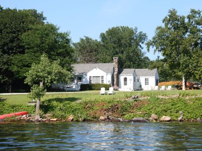 Photo for Lakeside cottage with west shore island sunsets and views of the Adirondacks.