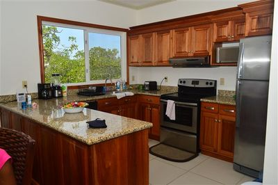 Bright New & Clean Kitchen for your Culinary enjoyment! Hire a chef to cook!
