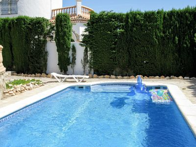 Photo for Cosy apartment for 6 people with WIFI, A/C, private pool, TV, balcony, pets allowed and parking