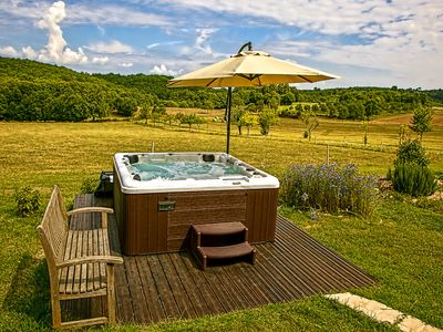 Relax in our fabulous Jacuzzi overlooking the beautiful Dordogne countryside