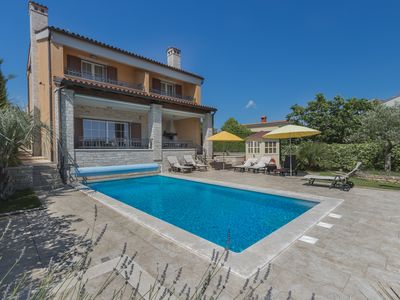 Photo for Luxury villa with heated pool near the sea in a quiet area