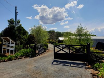 The entrance to Flourish Farms.  Turn in through the black gates.