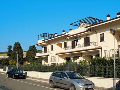 Photo for Lovely apartment for 4 guests with pool, A/C, balcony, pets allowed and parking