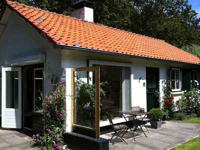 Photo for Holiday home with beautiful location in the forest, at the bottom of the dunes nearby Koudekerke.