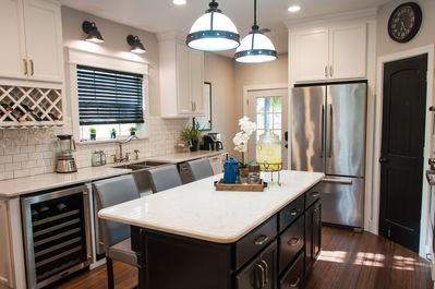 Beautiful brand new kitchen with built in ice maker and wine fridge