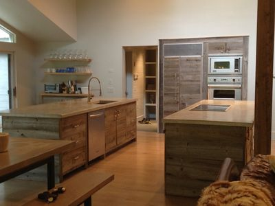 Newly renovated kitchen opens to eating and living areas