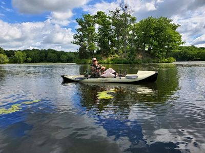 2019 June guest with bass on lake.