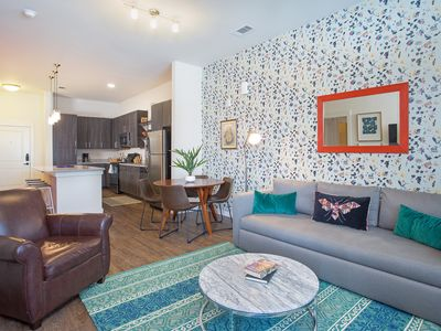 Photo for Dog-friendly apartment just north of downtown with shared pool and yoga room!