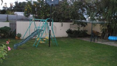 Back yard swings and sand pit