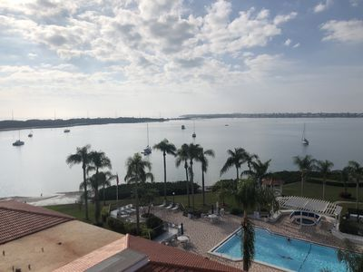 Photo for Dolphin watch each morning from the top floor balcony of this luxury condo!