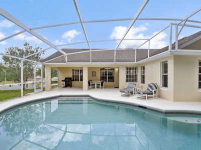 Photo for Floridian Home close to Disney, Wonderful Pool, Grill, Garage, Sleeps 8