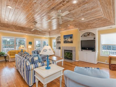 Photo for Spacious home on Canal with private dock and steps from ocean.
