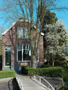 Photo for Charming detached house with garden in a quiet area, including cat care.