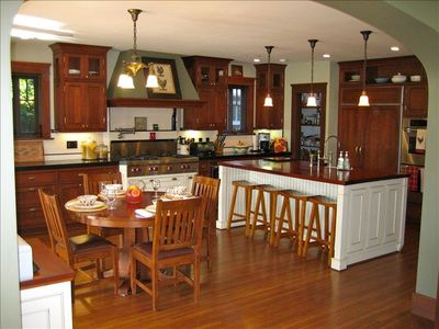 Spacious eat-in gourmet kitchen, opens out to patio, BBQ, pool and hot tub