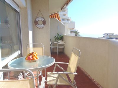 Photo for Beautiful, bright, frontbeach, sea views, terrace, 5 pools, wifi, A. C