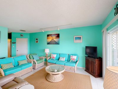 Photo for Bright waterfront condo w/ shared pool, hot tub, and a private boat slip!