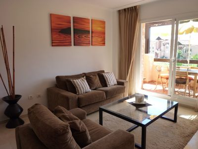 Photo for Luxurious apartment with 30MB wifi, south facing terrace, BBQ & sublime sea view