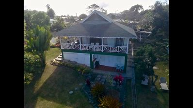 Aerial view of cottage from sea