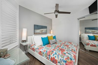 Master bedroom with king bed and closet.  The lights conveniently turn on and off with a touch on the base.  A flat panel tv is provided.  Bed linens are provided.  Bathroom is accessible through a private entrance and also through the hall.