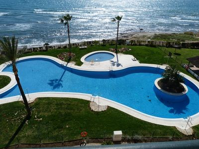 Main pool area with direct access to the beach