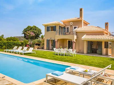 Photo for 5 minutes walk to the beaches and beachside tavernas, in a charming  countryside location, this delightful property is set amongst beautifully well kept gardens and manicured  lawns  surrounding the swimming pool and terrace