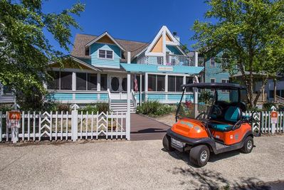 Front exterior view of Sun King with the house cart included in your rental.