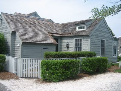 Nantucket style condo, exterior and entrance with adjacent parking space