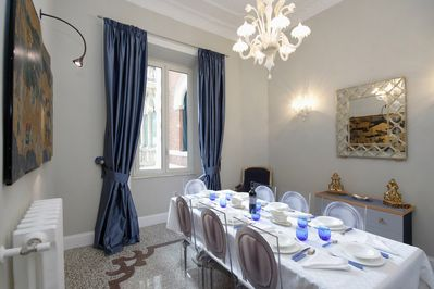 Dining room has fine art, interesting combination of traditional and modern.