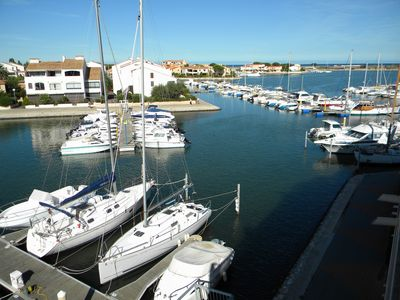 Photo for 54m² apartment rental with view of boats, shaded and sunny St Cyprien