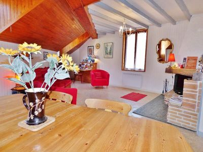 Photo for Spacious loft apartment with a chalet feel in the main square of Moutiers.