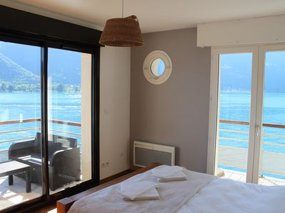 Photo for Apartment overlooking Lake Annecy with lake access and private pontoon