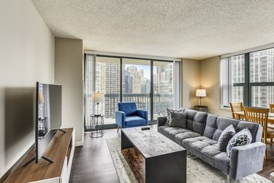 Living Room Features Floor to Ceiling Windows