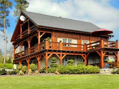 Photo for Affluent Chalet in Septon with Whirlpool, Sauna & Jacuzzi